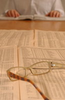 Image of spectacles and paperwork