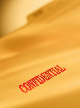 Image of file folder marked confidential
